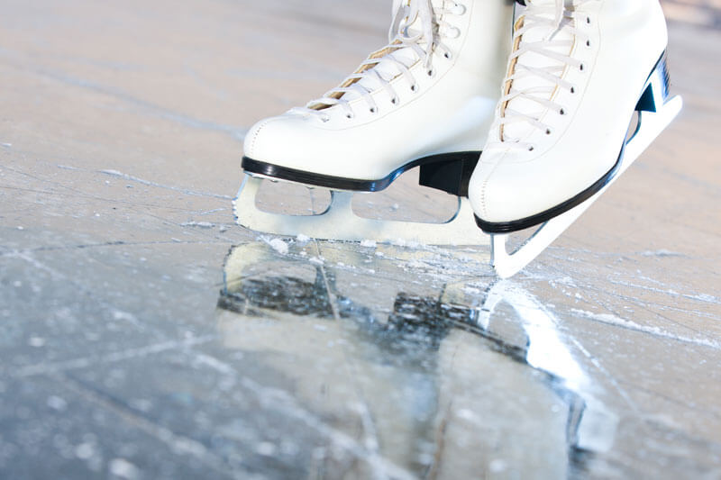 An ice skating rink shows the effects of temperature and pressure on state, freezing water into ice.
