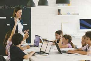 Teacher using online educational games with her blended learning teaching model