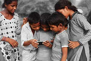Kids around tablet playing online educational games