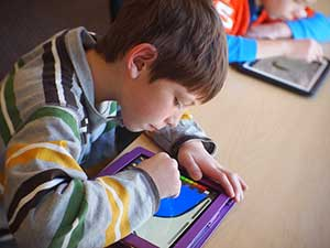 Child doing work in a blended learning classroom