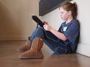 Girl playing an online educational game on her ipad