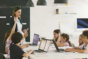Teacher using game-based learning in her blended learning classroom
