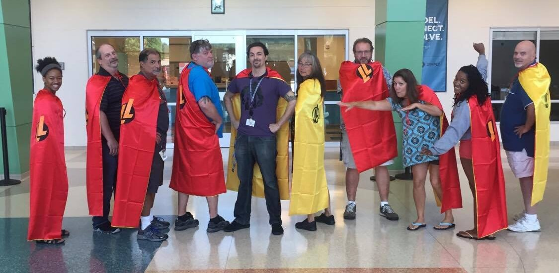 group of teachers all wearing LL capes
