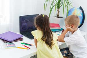 Children using online educational games in their distance learning class
