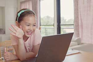 Girl socializing with her classmates during remote learning